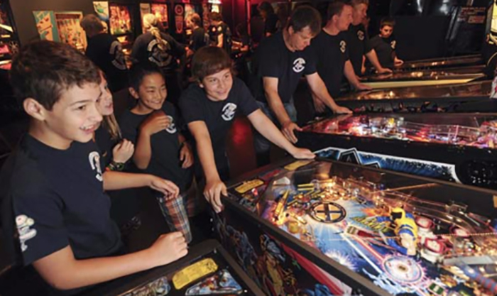 kids playing pinball